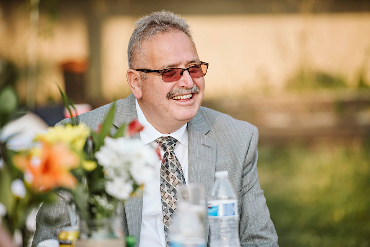 Bride's father smiles during toasts