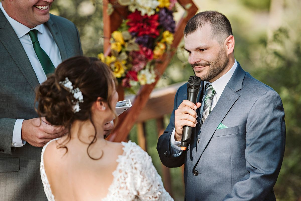 Groom says vows into microphone