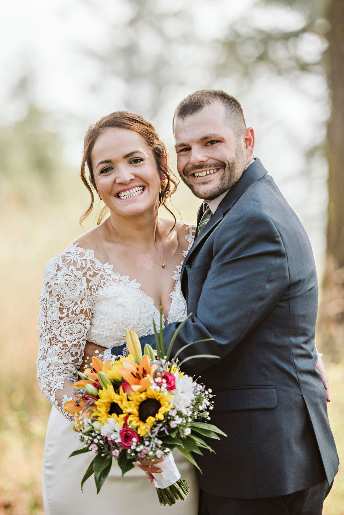 Couple smiles after ceremony