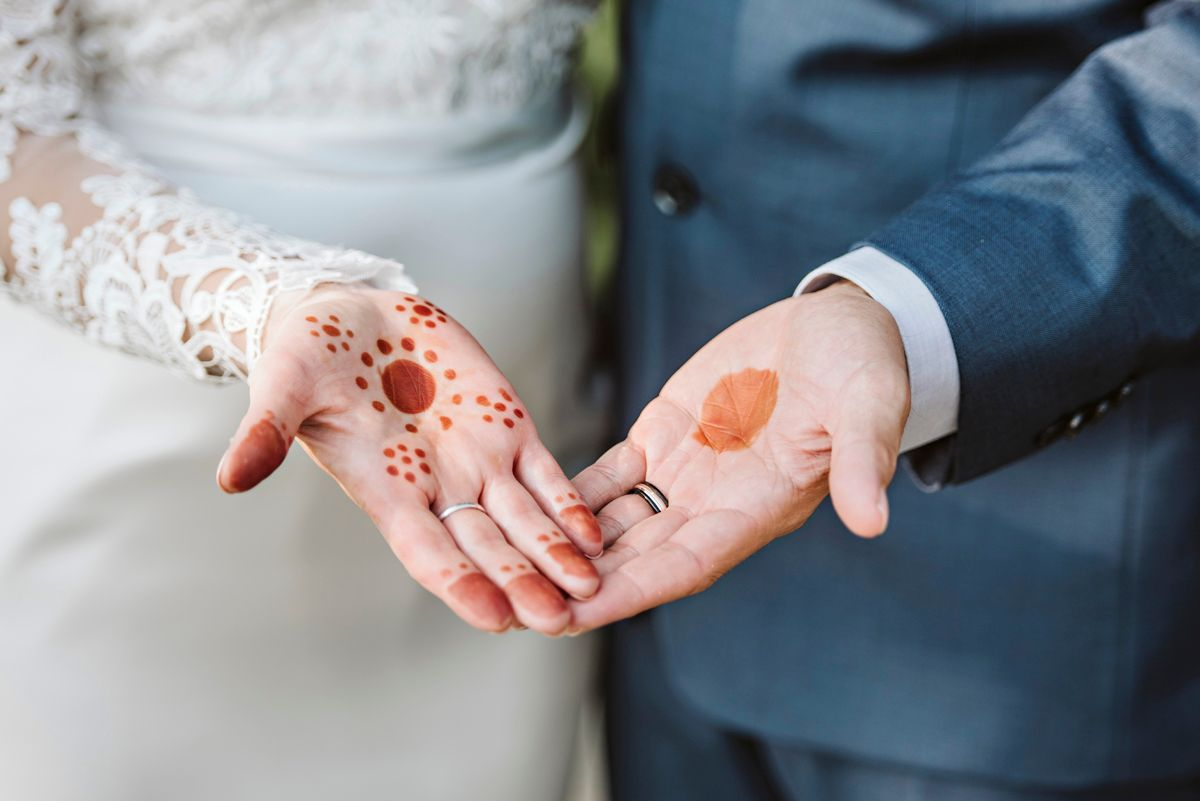 Couple shows off henna painted hands