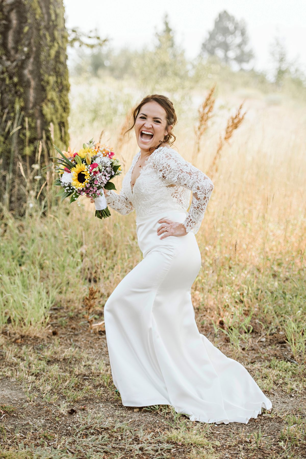 A sassy bride poses and laughs