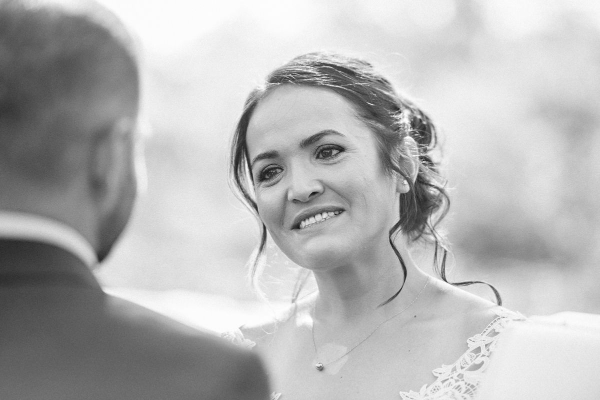 Close-up of smiling bride in black and white