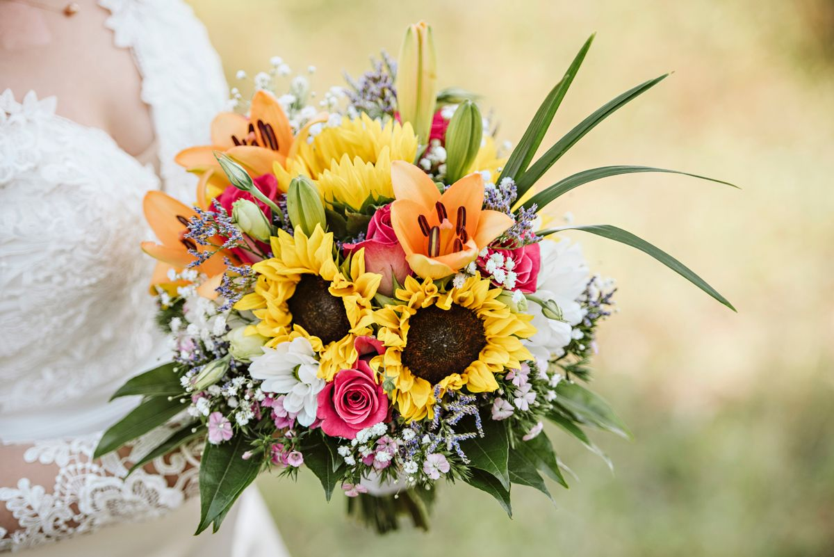 Beautiful late summer flowers adorn this gorgeous bridal bouqet