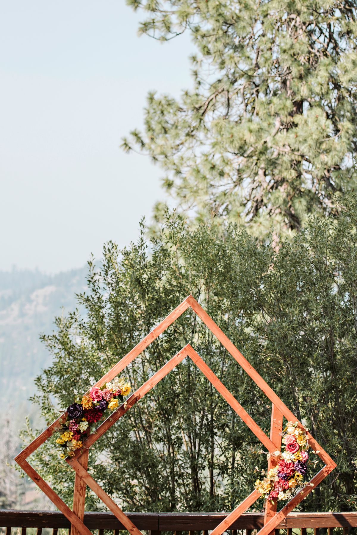 Home made wooden wedding arch with silk flowers