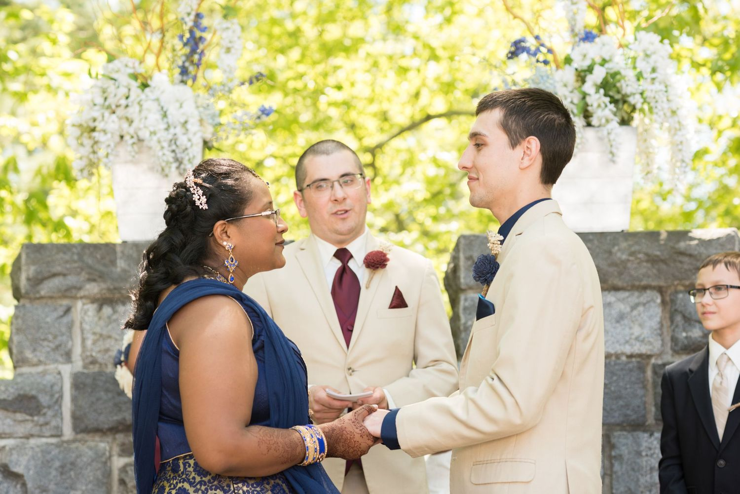 Leah Ramuglia Photography bride and groom exchange vows during their wedding at Searles Castle in Wyndham, New Hampshire