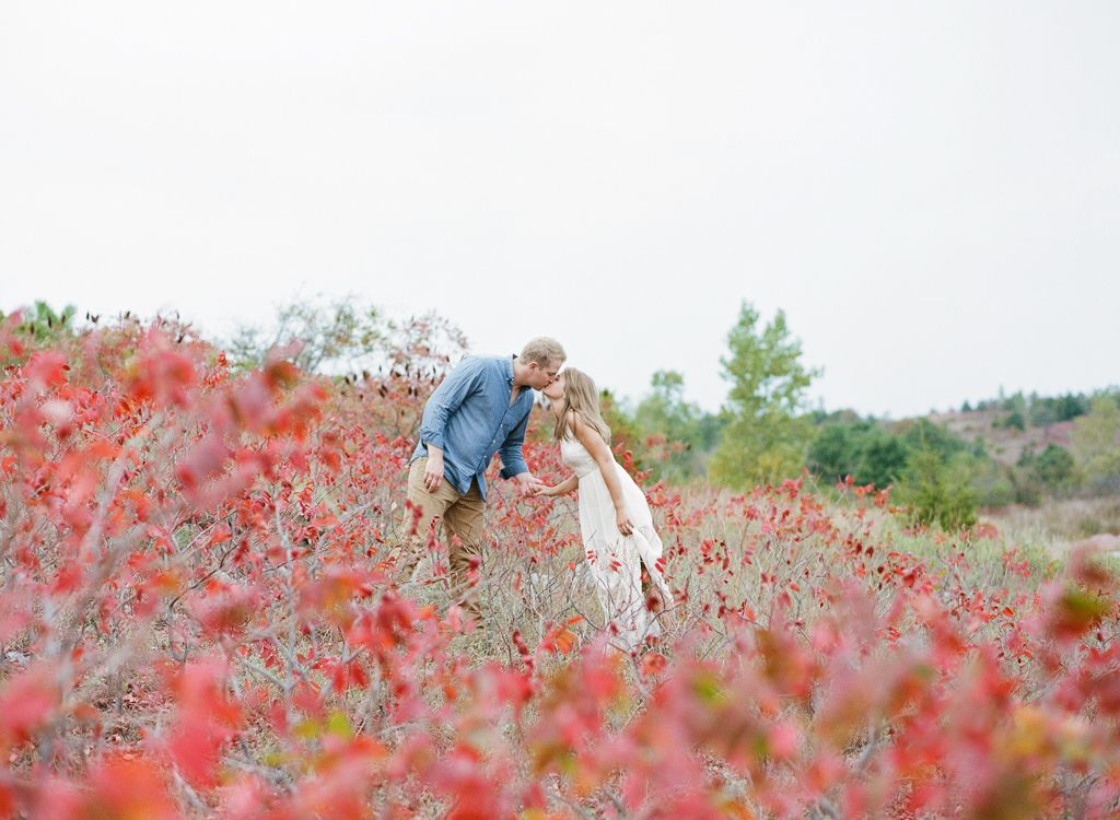 Oklahoma wedding photographer engagements Aaron Snow Photography Turner Falls Davis couple holding hands film fall