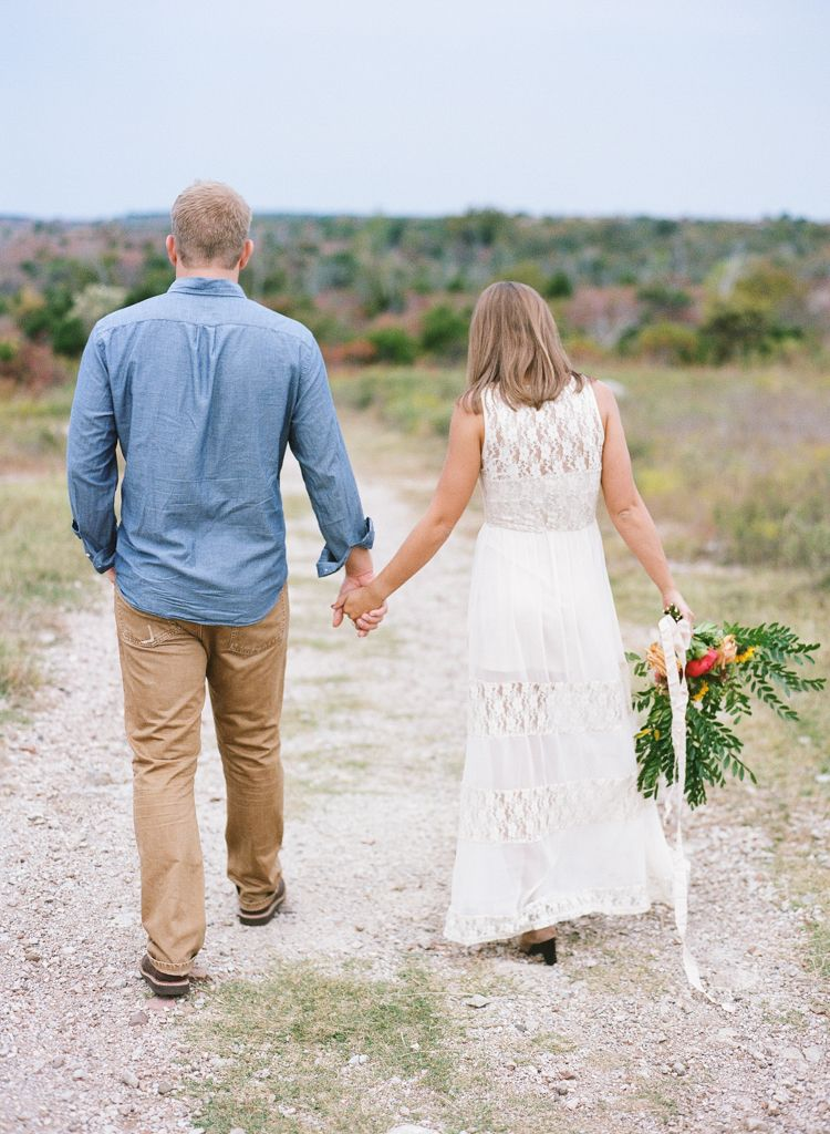 Oklahoma wedding photographer engagements Aaron Snow Photography Turner Falls Davis couple holding hands film camera