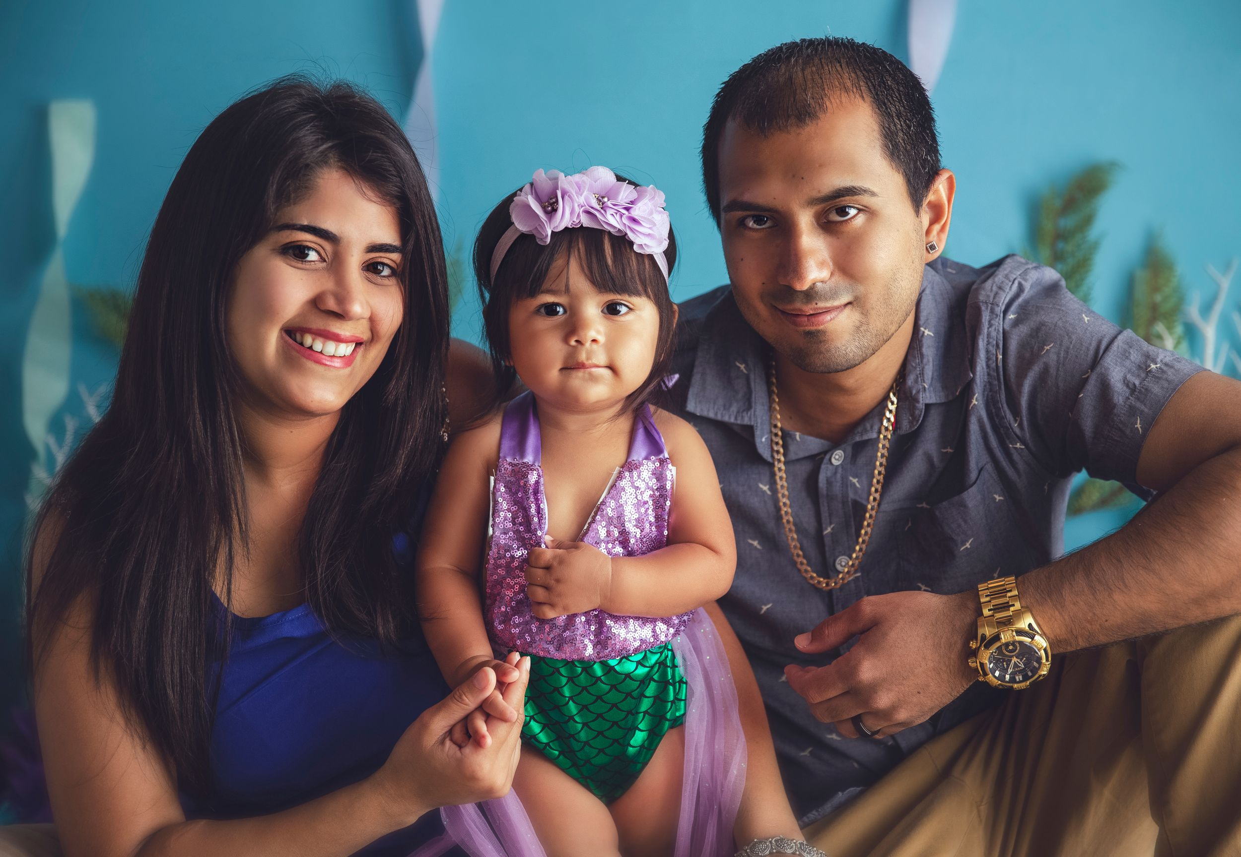 one year old session baby girl with parents mom and dad