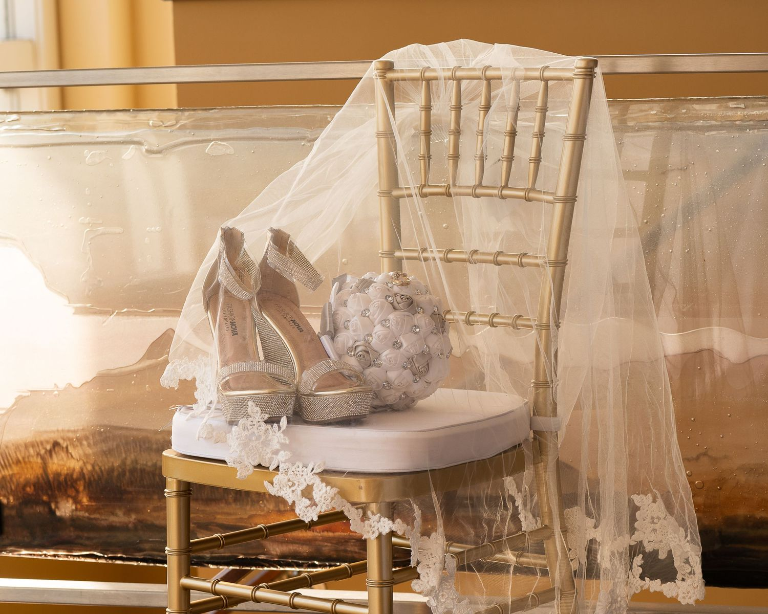 bride's shoes, veil, rings, and flowers at the river club of mequon