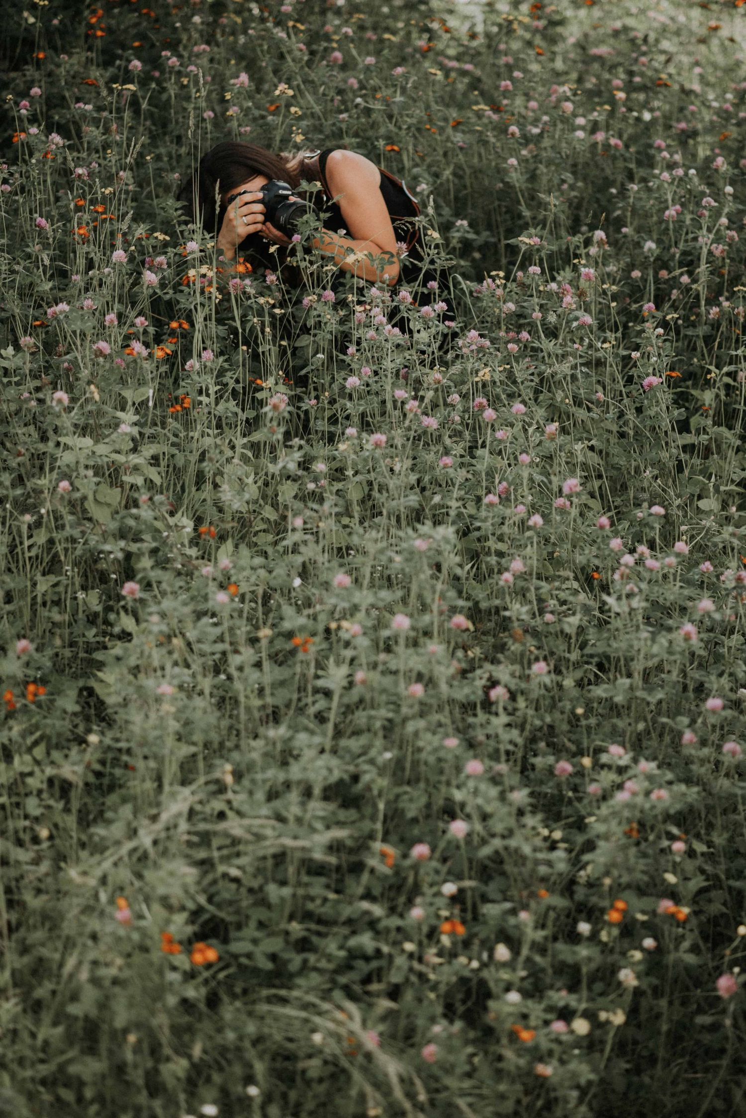 behind the scene shooting a couple in a bunch of flowers