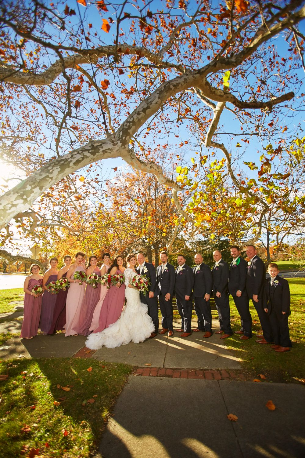 gorgeous fall color in this wedding party formal at roger williams park in providence rhode island