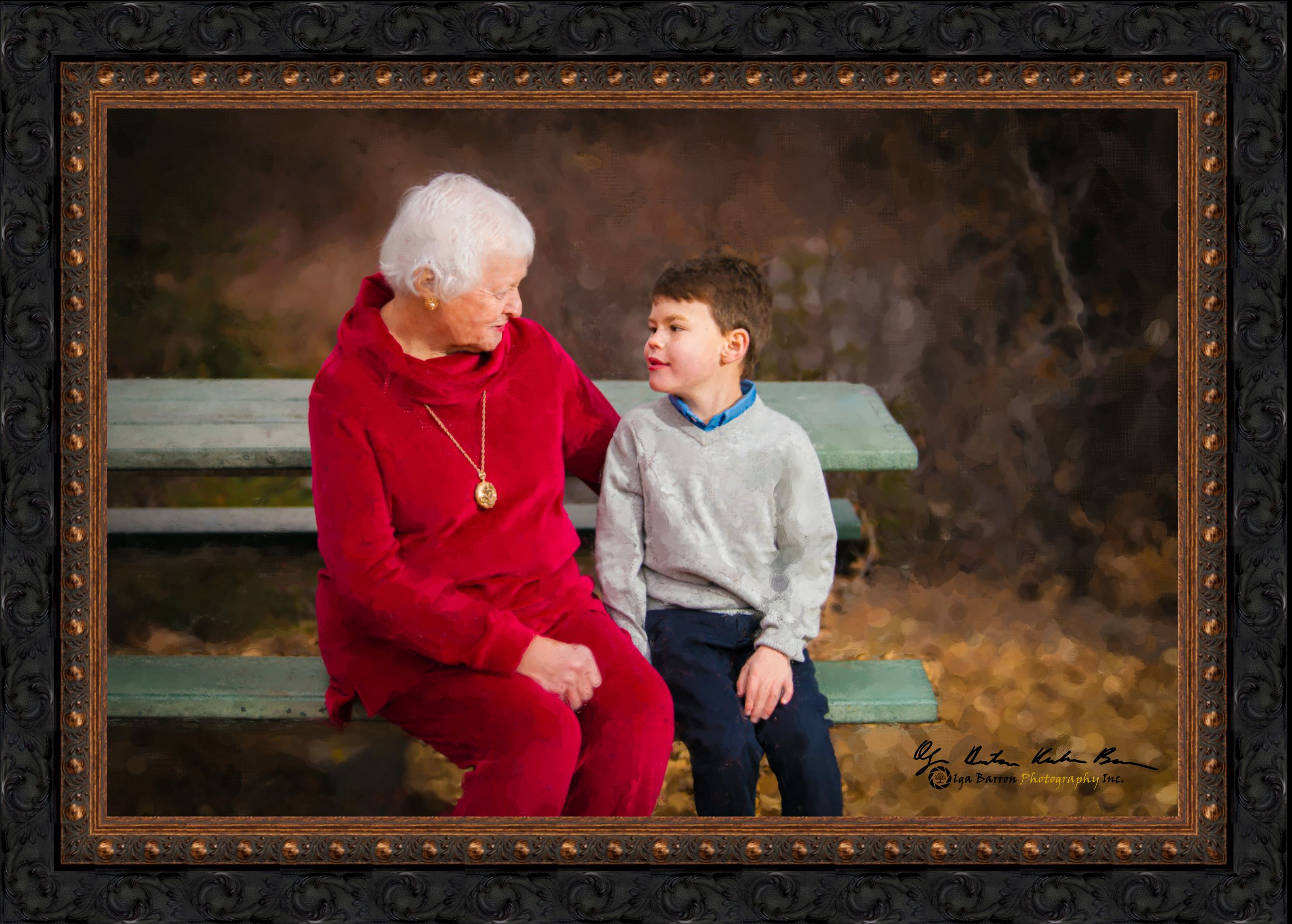 Framed painterly portrait of a grandma and grandson at a picnic table in the fall