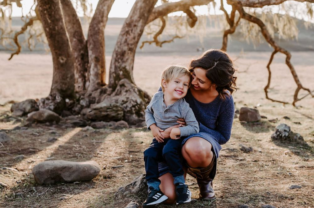 Sonoma County family photography session at sunset showing motherhood and fatherhood with young son