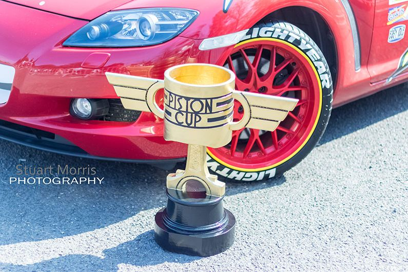 close up of disney pixar lightning mcqueens front bumper and wheel with the piston cup