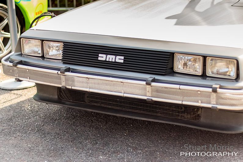 close up of the front of a delorean at stars and cars charity event