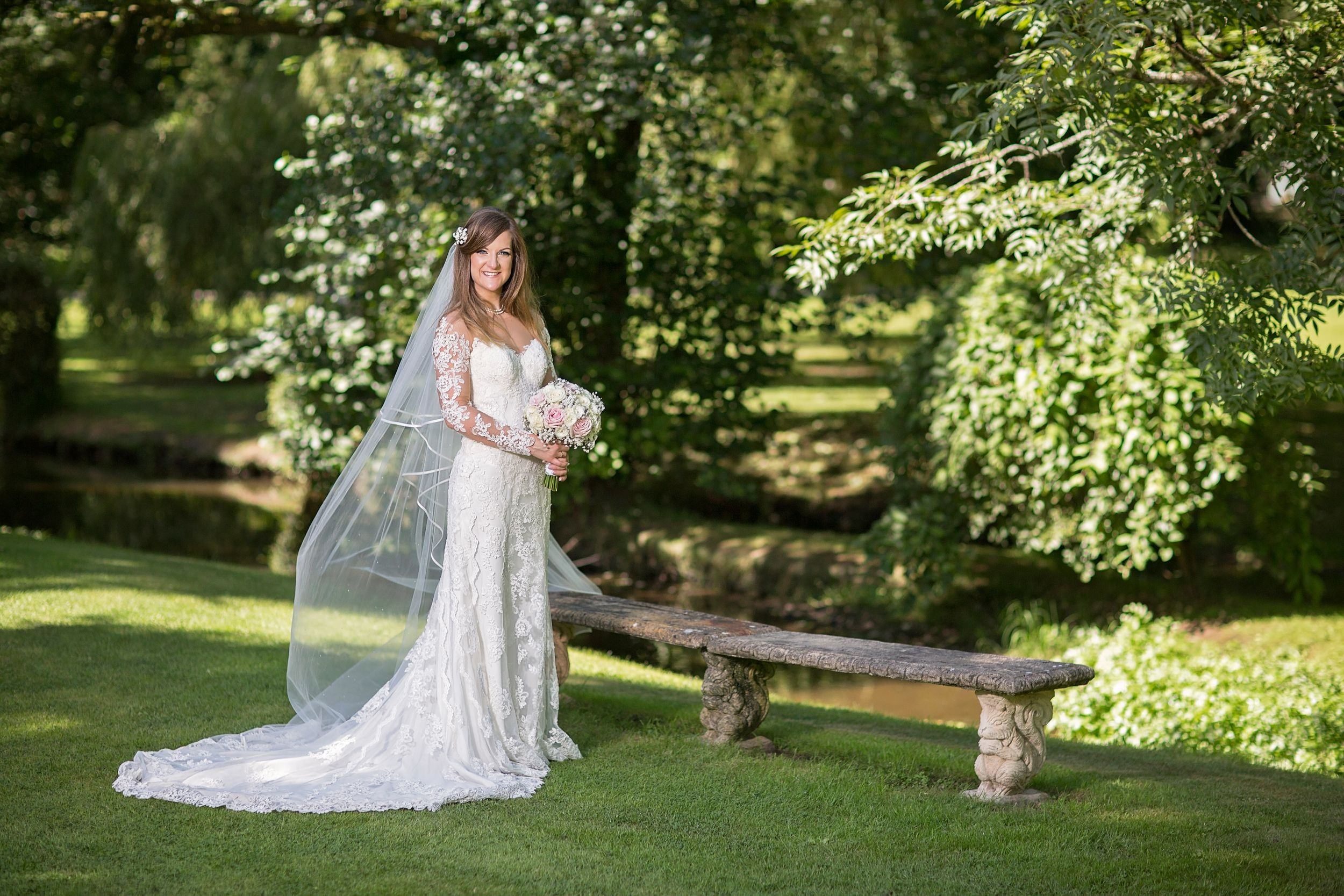 bride in the grounds at her wedding at Pencoed House