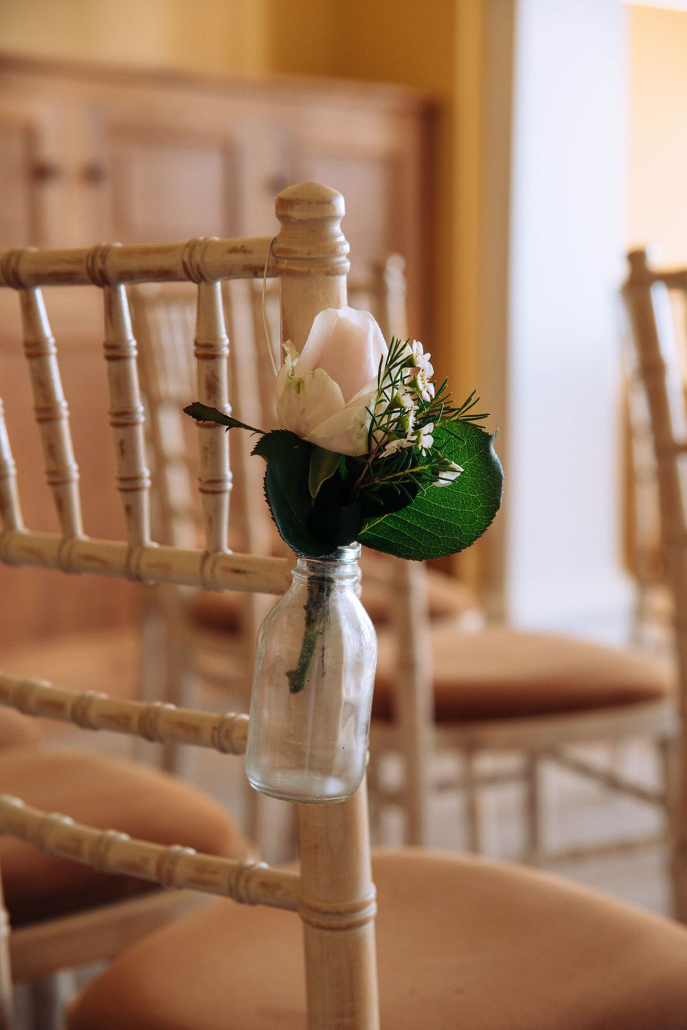 Zara Davis Wedding Photography Near Stroud, Gloucestershire, Cotswolds Glenfall House flowers on chair