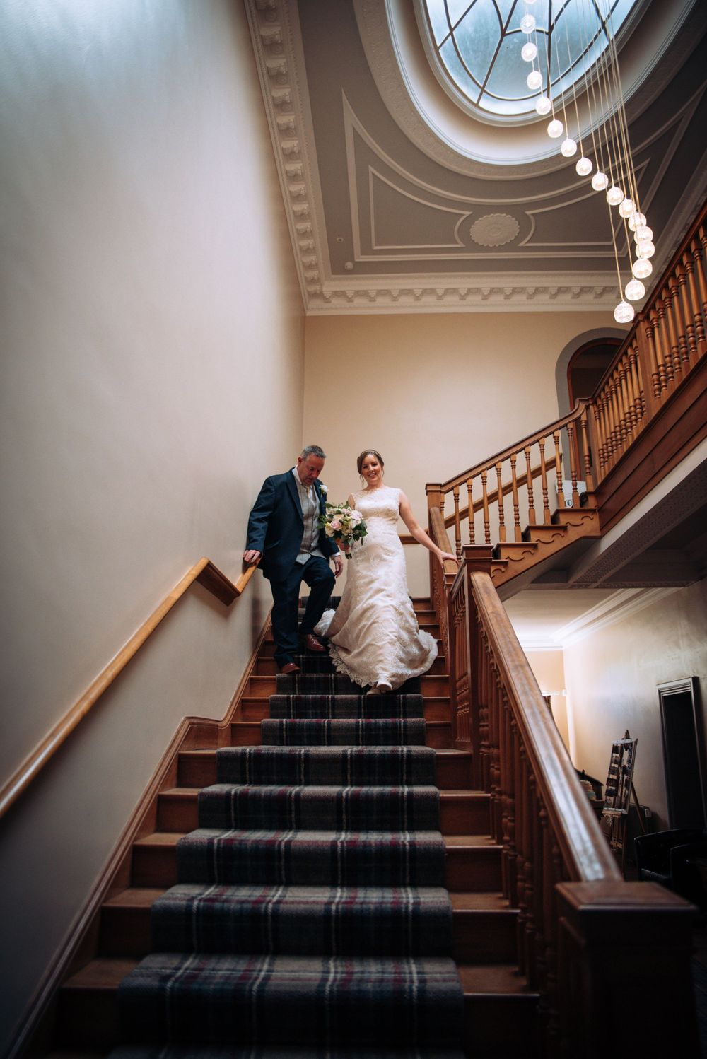 Zara Davis Wedding Photography Near Stroud, Gloucestershire, Cotswolds Glenfall House descending staircase bride