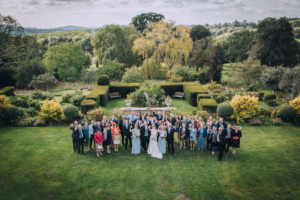 Zara Davis Wedding Photography Near Stroud, Gloucestershire, Cotswolds Glenfall House group portrait scenic