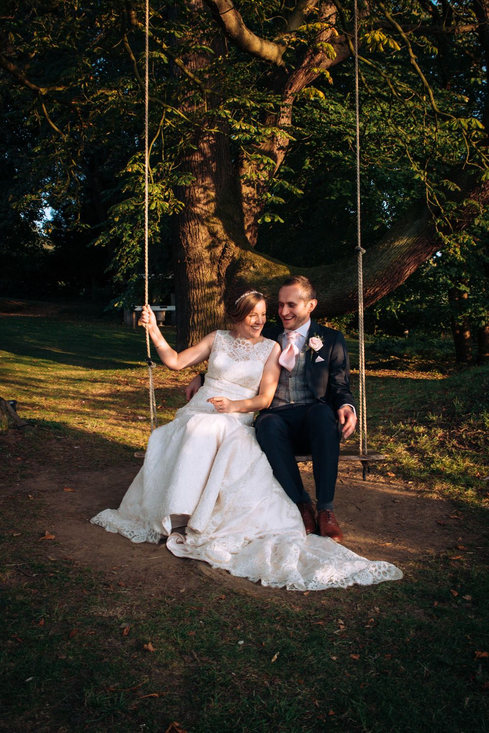 Zara Davis Wedding Photography Near Stroud, Gloucestershire, Cotswolds Glenfall House sunset bride and groom on swing