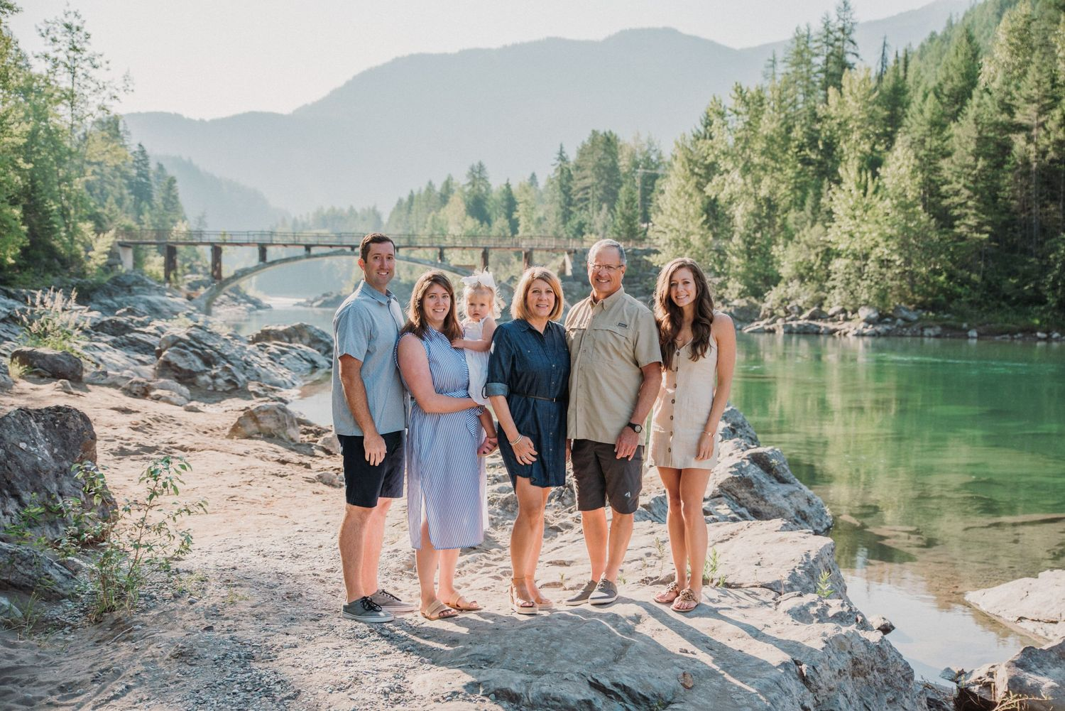 family of 6 standing together posing in west glacier Montana