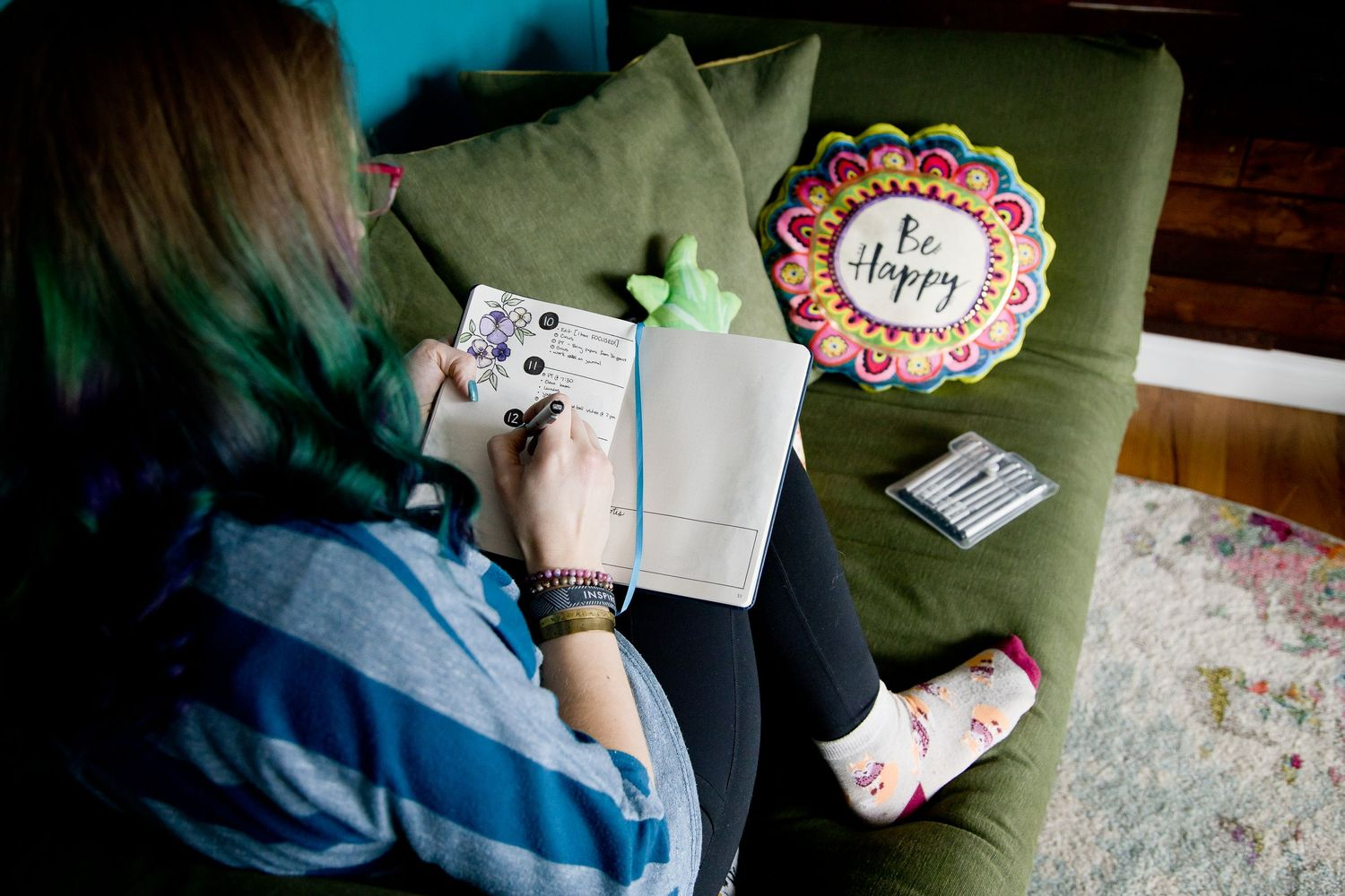woman owned lifestyle branding session bullet journaling on couch at home in Auburn WA