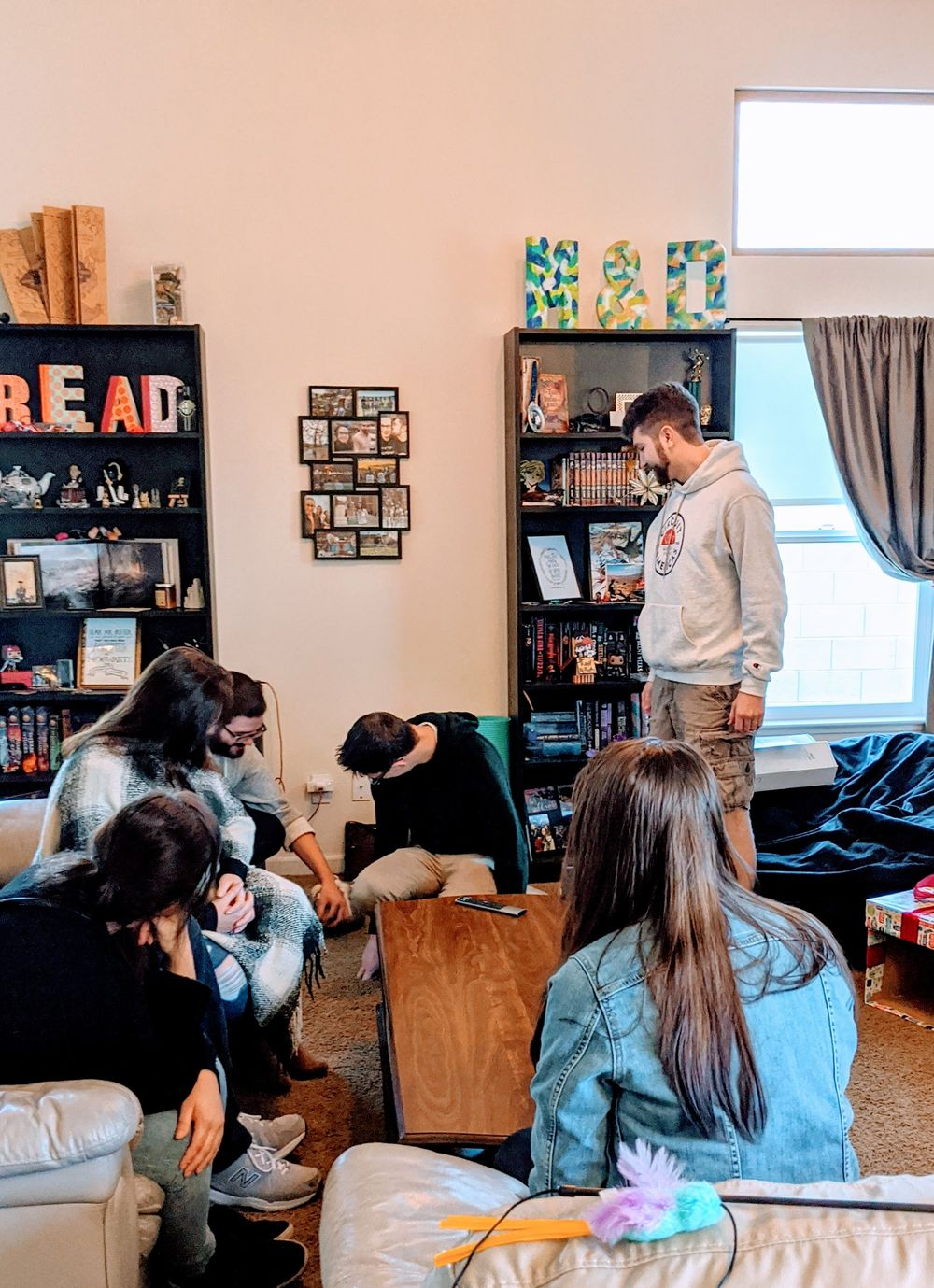 a group of friends and family in a living room