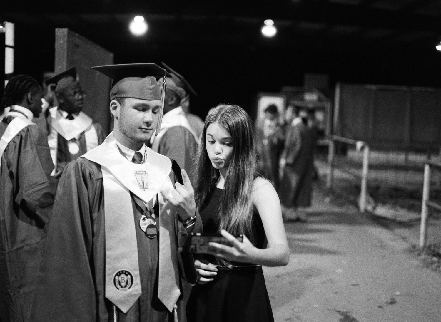 A senior in the class of 2020 at Franklinton High School and his sister after his graduation.