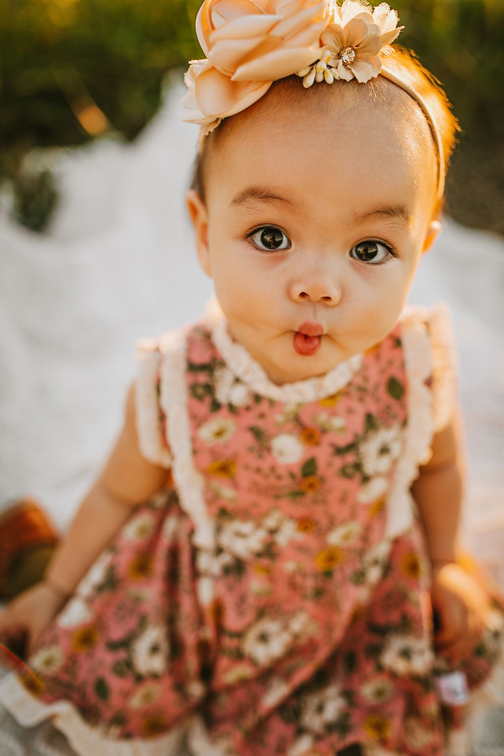 toddler making a fish face in a dress