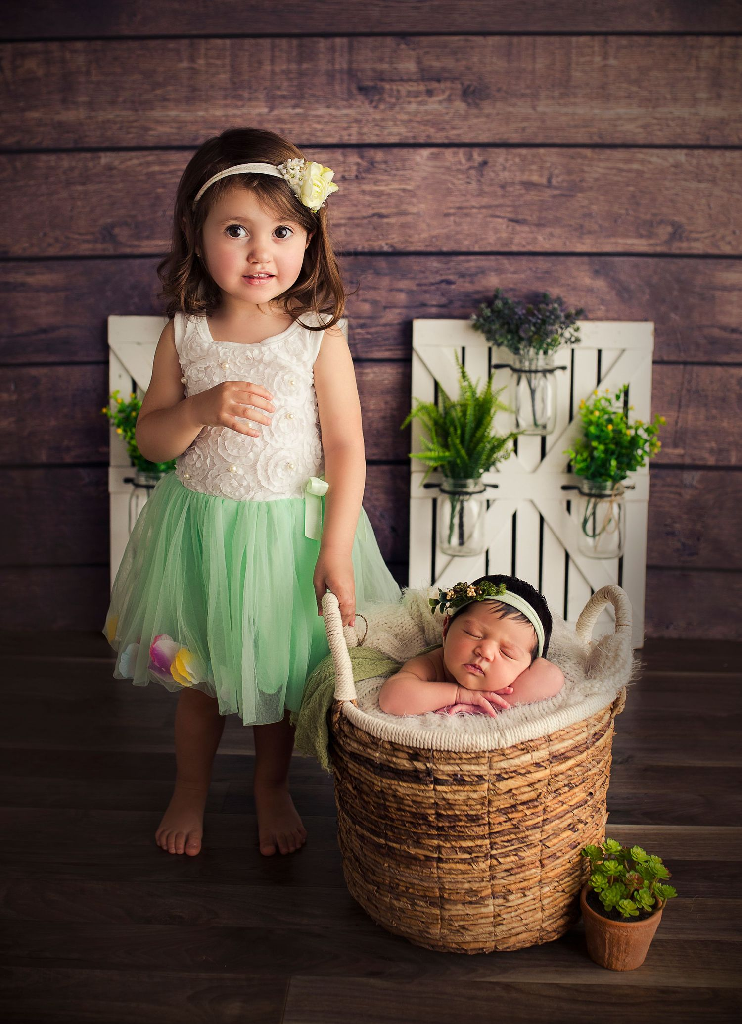 big sister and newborn baby pose for detres photography