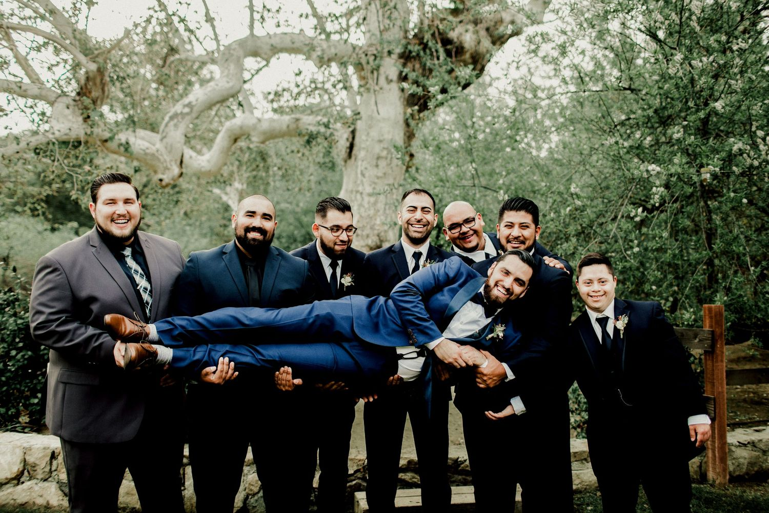 groomsmen carrying groom at calamigos ranch