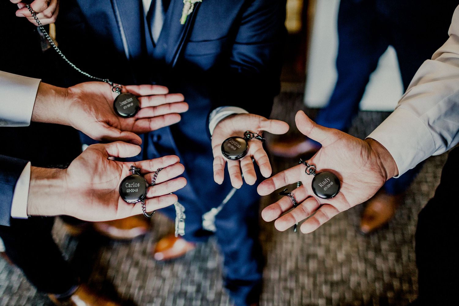 shot of custom pocket watch with groomsmen engravings