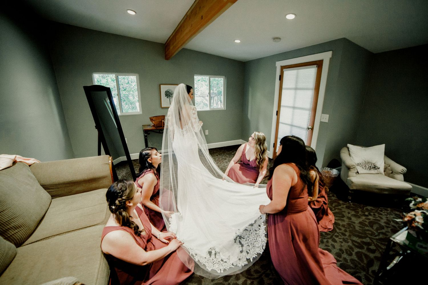 bridal party helping bride with dress