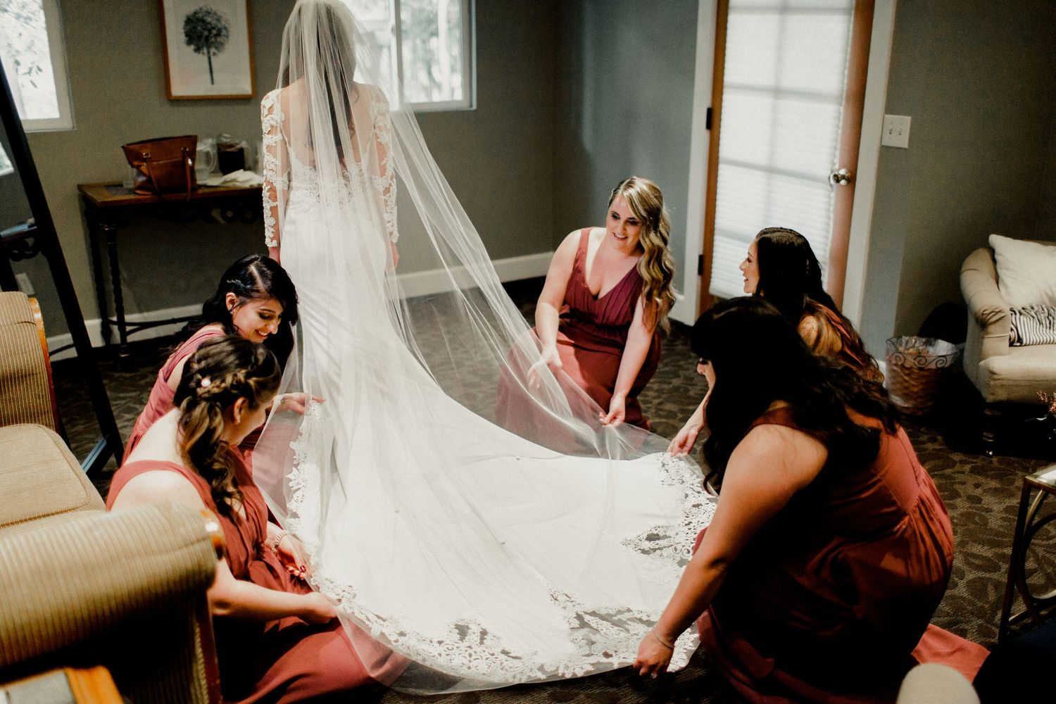 bridal party helping dress
