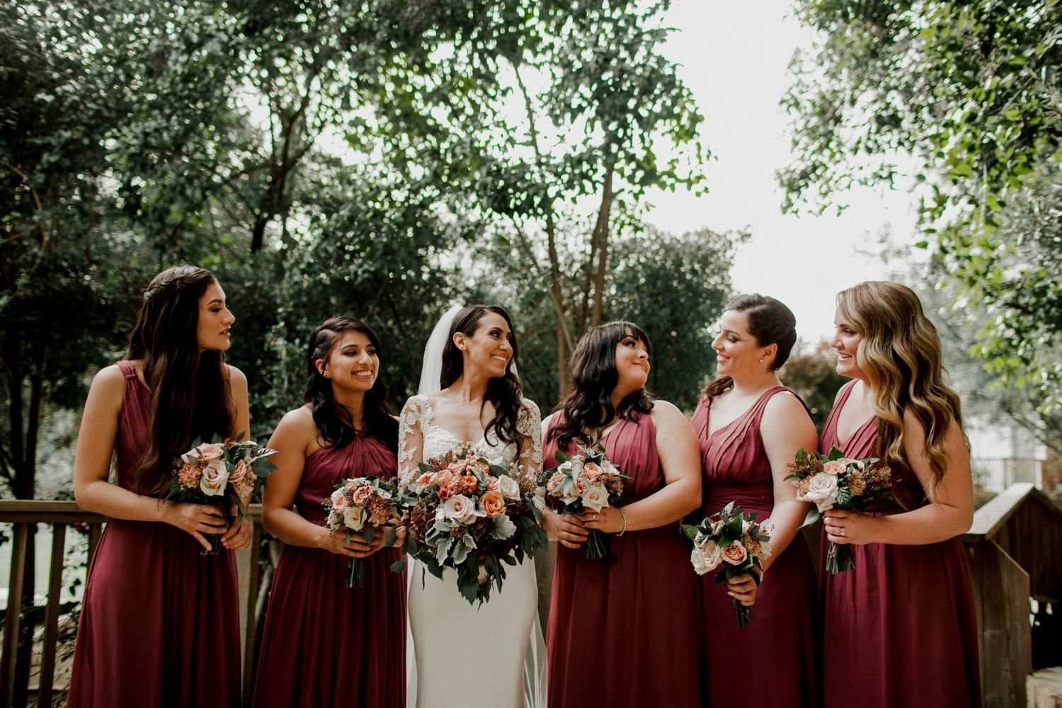 bridesmaids talking amongst each other at calamigos ranch malibu