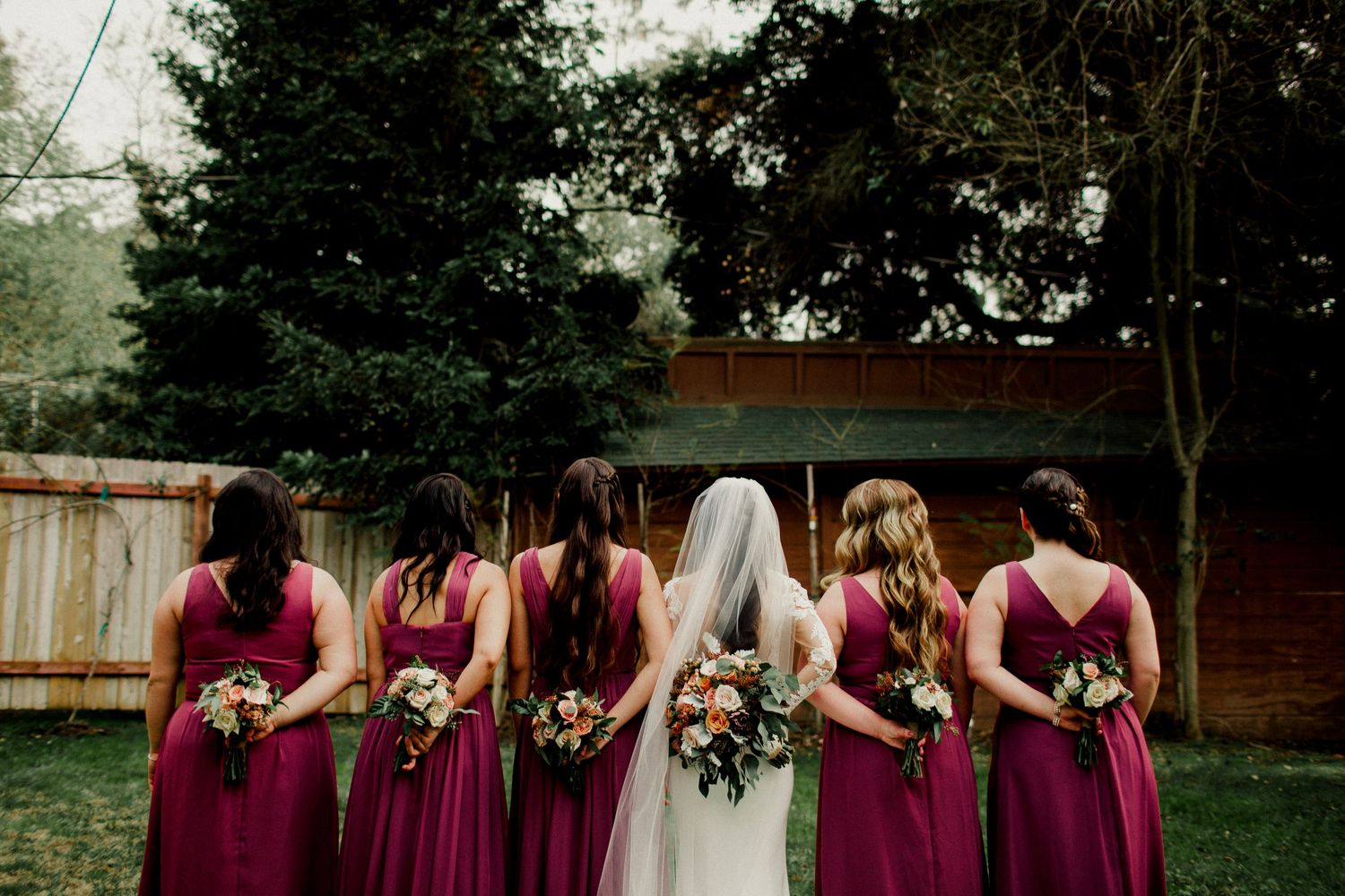 back of bridesmaids and bouquet