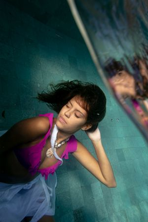 A woman in a pink bikini top underwater