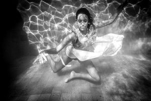An underwater ballerina in a white skirt
