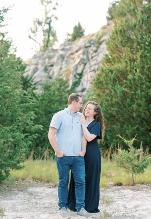 Klondike Park Photography of couple in navy blue dress holding hands by St Louis Wedding Photographer JKG Photography