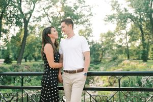 Forest Park Photography of couple in black spotted dress holding hands by St Louis Wedding Photographer JKG Photography
