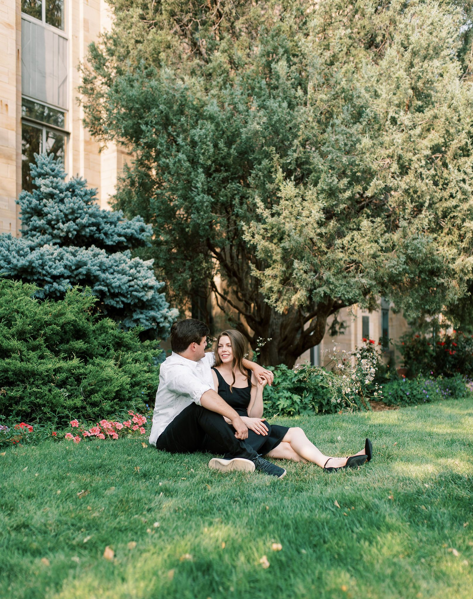 Colorado Photography of couple sitting in Pearl Street Mall by St Louis Wedding Photographer JKG Photography