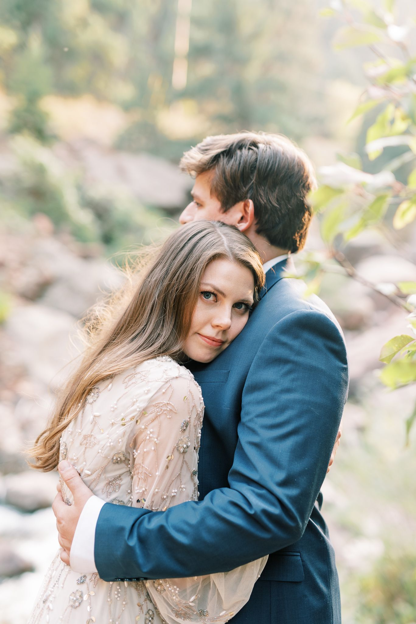 Colorado Photography of couple hugging in mountains by St Louis Wedding Photographer JKG Photography