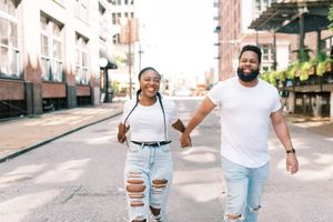 St. Louis City Photography of couple in white holding hands by St Louis Wedding Photographer JKG Photography