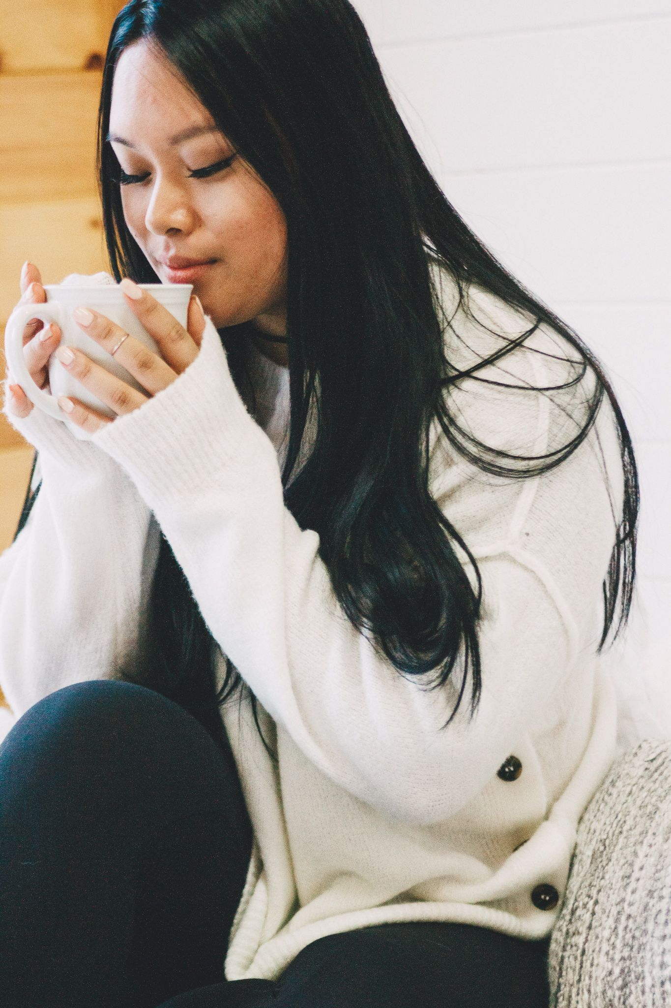 lifestyle headshot of women smelling coffee