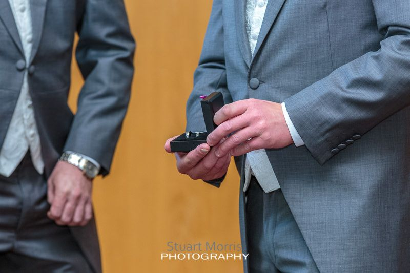 close up of the groom opening the ring box to check they're still there