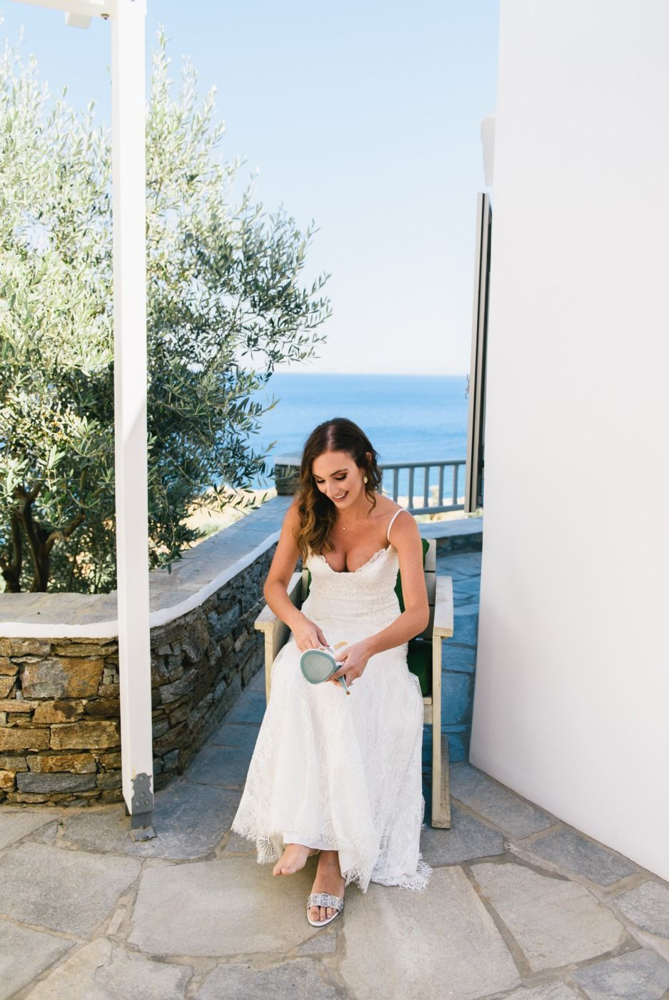 bride puts her wedding shoes at sifnos