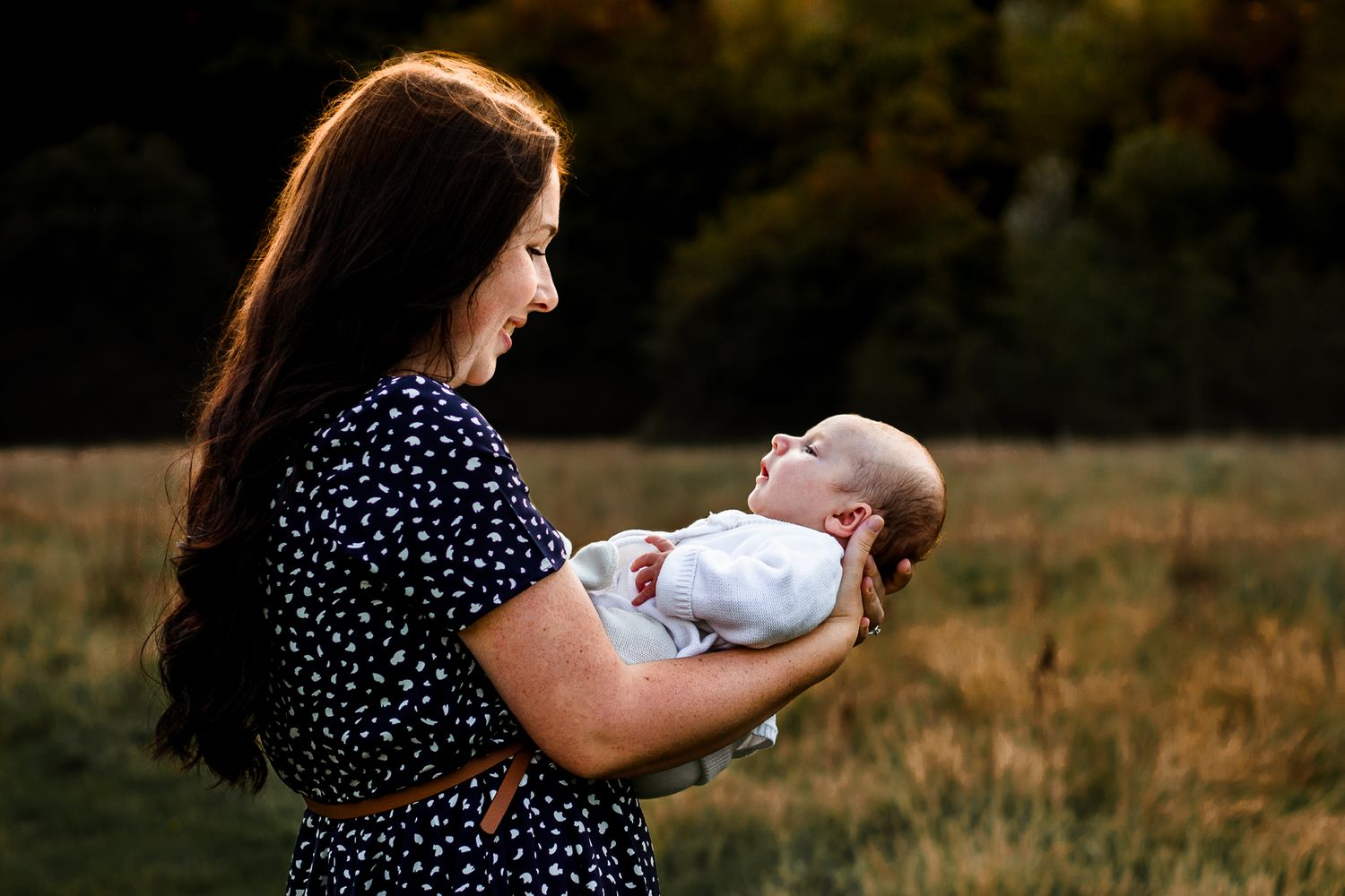 In a field in Havant, Hampshire, a new mum holds her newborn baby boy.