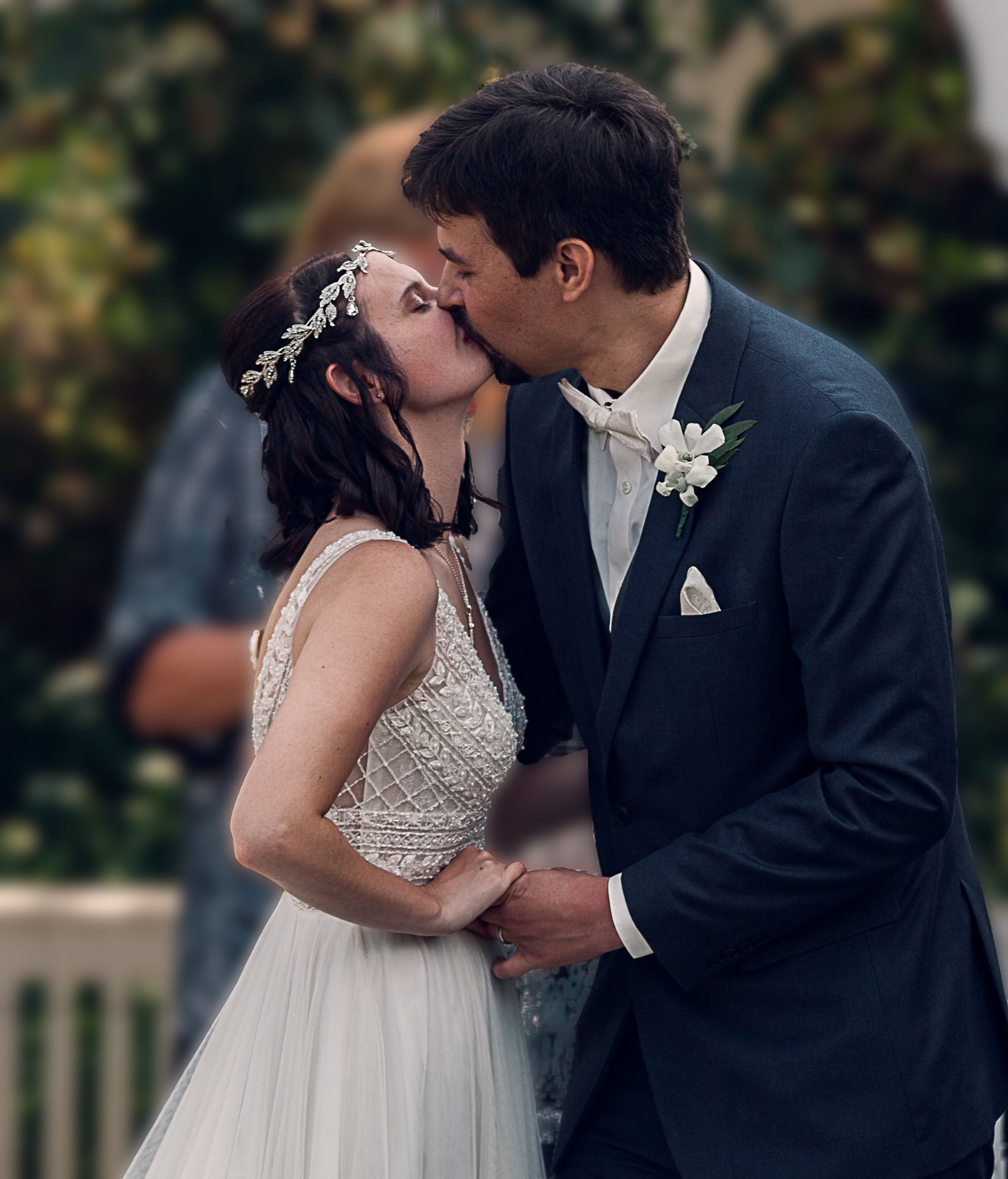Newly married couple share first kiss during their outdoor wedding at the Buffalo Erie County Botanical gardens