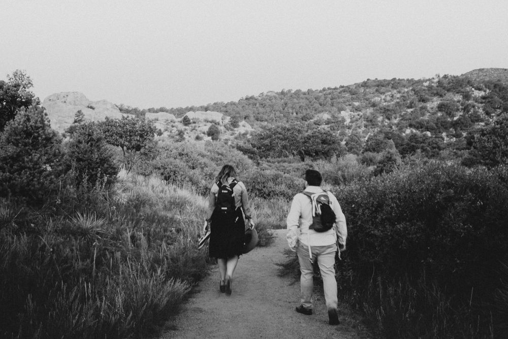 couple hiking in Denver Colorado after getting engaged