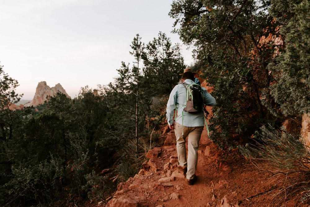 couple hiking in Colorado during their adventurous couples session